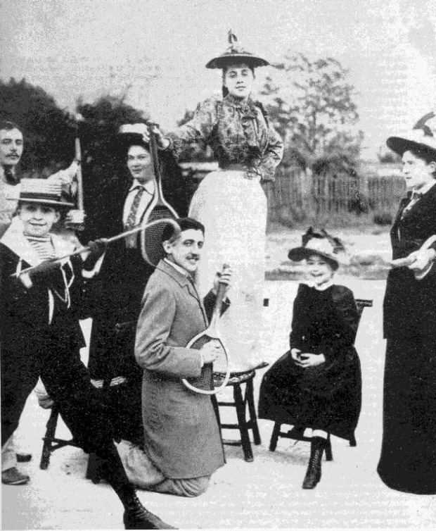 Proust. Hanging with his homies, back when tennis racquet guitar was cool, as well as standing on chairs.