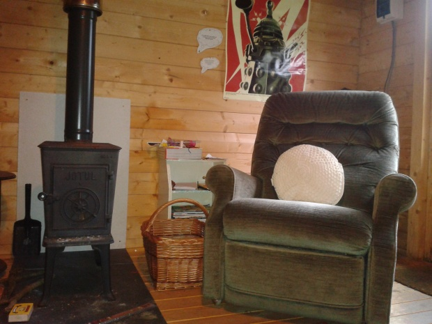 cabin, woodstove, reading chair