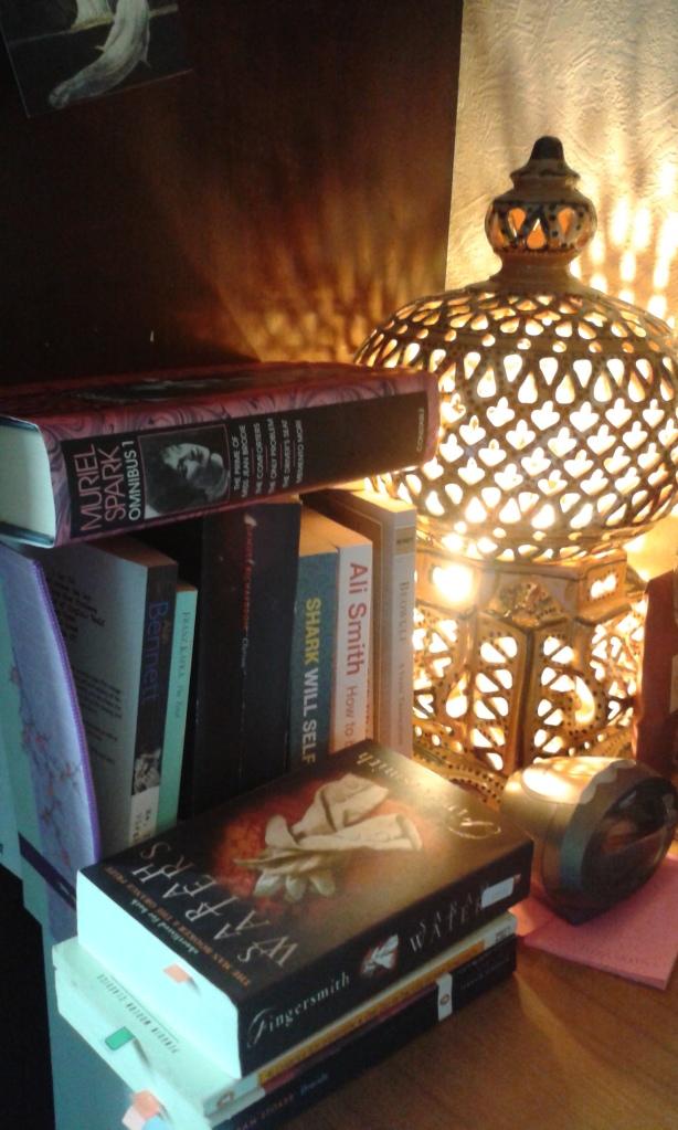 bedside book pile
