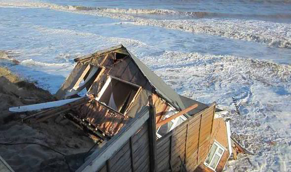 coastal erosion house falls off cliff